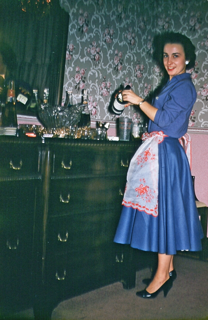 Martha in blue dress with apron